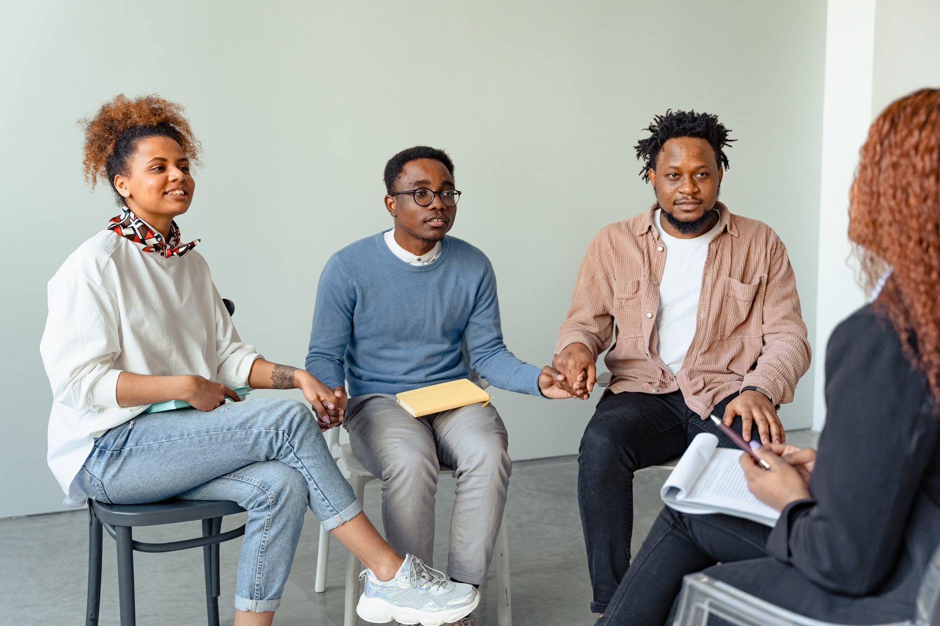 people in a psychotherapy session with a psychologist